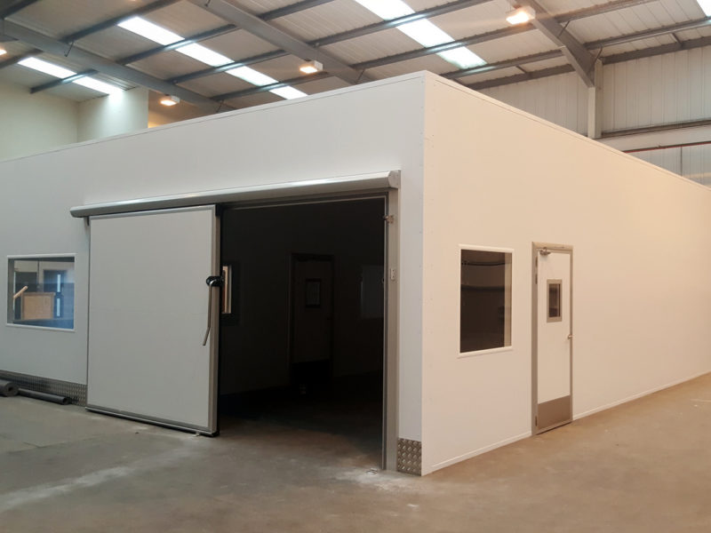 Sliding door access for triple compartment cleanroom