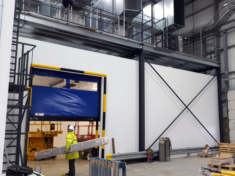 Rapid rise doors for easy access to food freezer facility