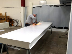 Cutting panels for a cleanroom installation