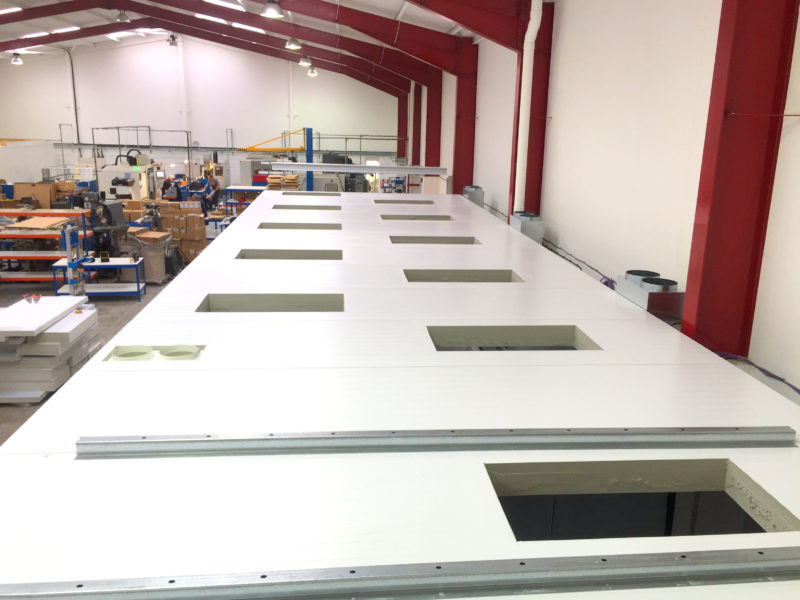 Cleanroom ceiling with openings for HVAC filter system