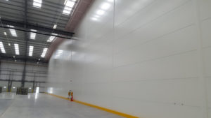 Horizontal fire rated panel installation for supermarket warehouse