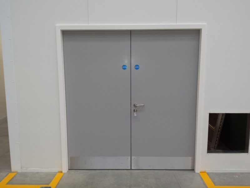 Fire rated access door in supermarket warehouse