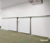 Food safe partitioning for meat conveyor room